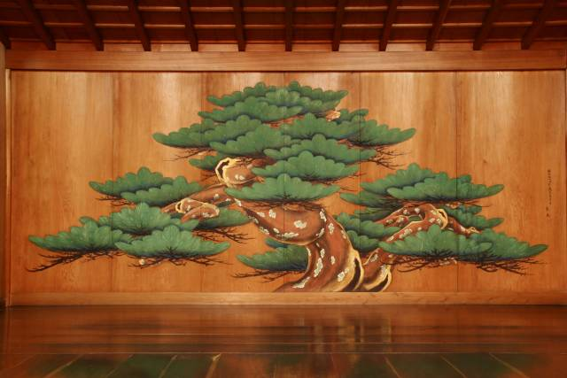 Noh theater stage with revered old pine tree